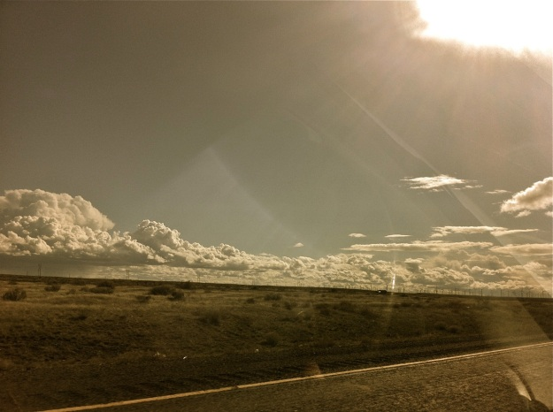driving west, clouds